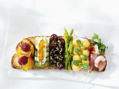 Slice of toast with several different toppings