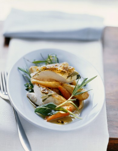Roast chicken with herbs stuffed under the skin with vegetables