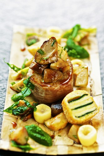 Veal fillet with porcini mushrooms, gnocchi, parsley cream and French toast