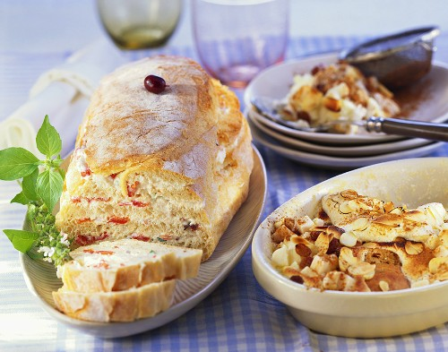 Filled ciabatta and apple and raisin pudding with almonds