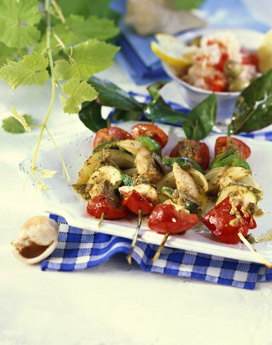 Redfish, pepper and courgette skewers