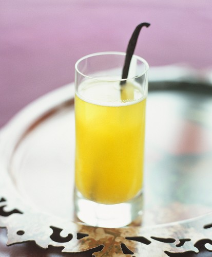 An apricot champagne cocktail with a vanilla pod