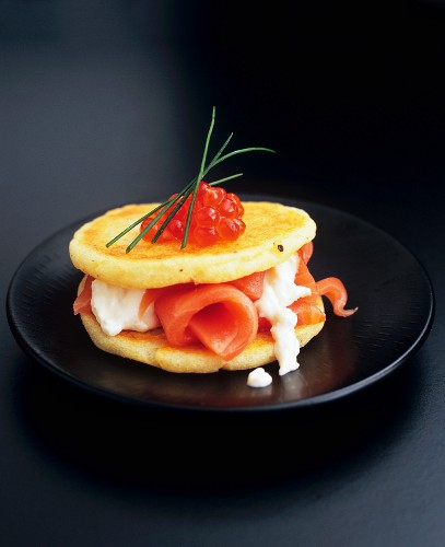 Potato pancakes with smoked salmon, horseradish and caviar