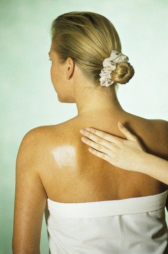 Woman having Bach Flower Essences rubbed into her back