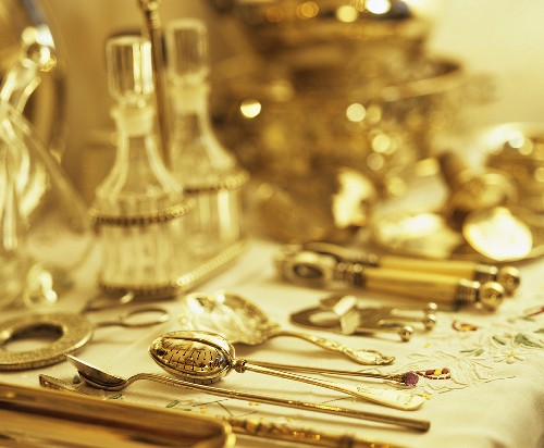 Silver cutlery, silverware and glass carafes