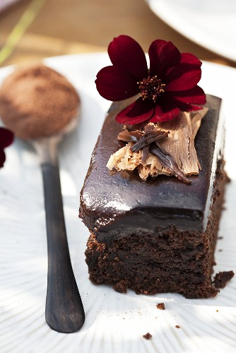 A chocolate slice with a chocolate flower