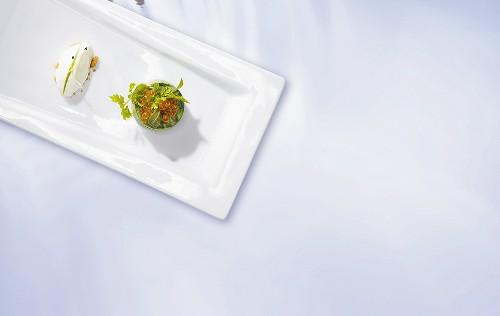Herb blini with caviar and creme fraiche gnocchi (molecular gastronomy)