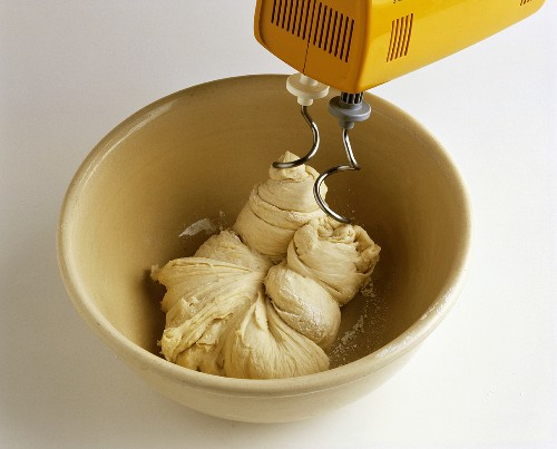 Kneading yeast with the dough hook of a food mixer