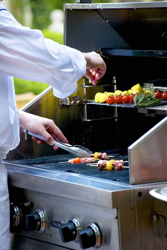 Vegetables and skewers on barbecue