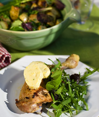 Grilled chicken legs with lemon butter and rocket