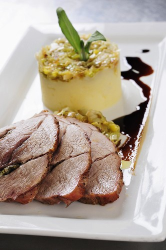 Pork roulade with mashed potatoes and a leek medley