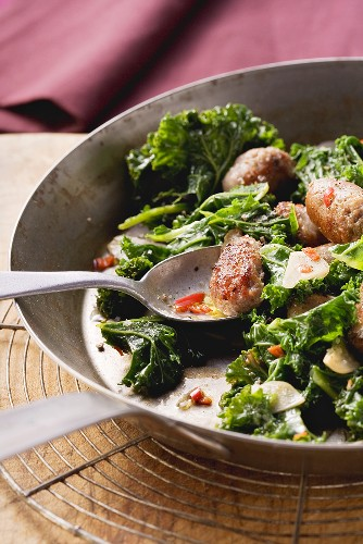 Spicy green cabbage with sausages