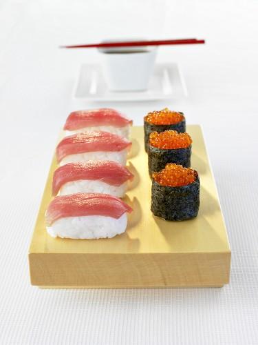 Tuna nigiri sushi and gunkan maki with salmon caviar