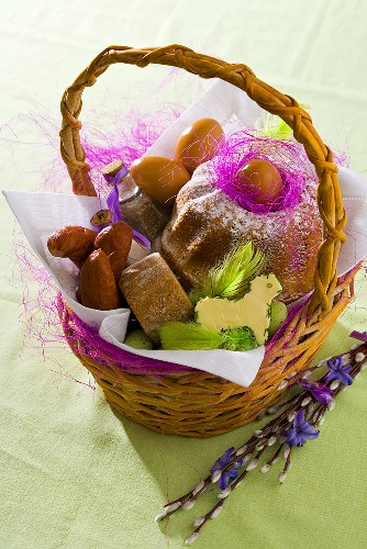 Sausage, eggs and baba (Polish rum cake) in Easter basket