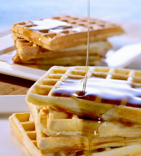 Waffles and apple and cinnamon waffles with maple syrup