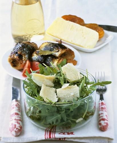 Rocket with Parmesan, sardine rolls and Brocciu cheese