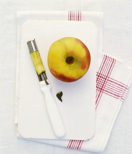 An apple and a corer