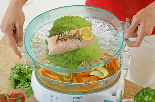 Fish and vegetables in a steamer
