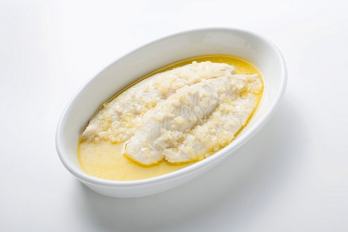 Pangasius fillet poached in butter