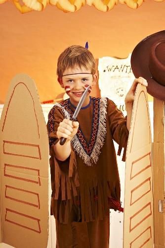 A little boy dressed as an Indian