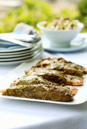 Salmon steaks wrapped in vine leaves