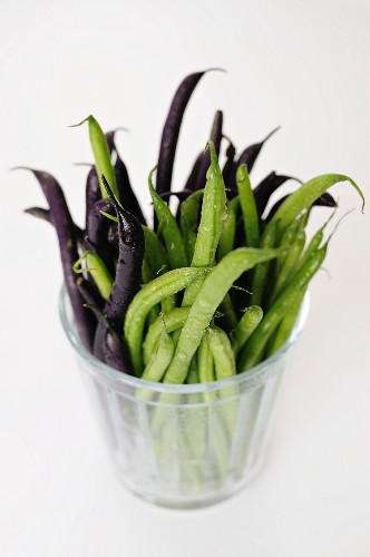 Freshly washed green and black beans in a glass