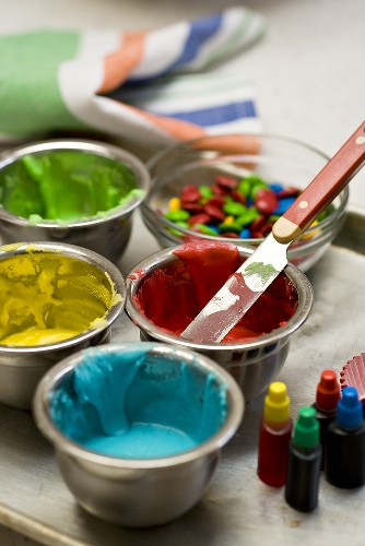 Coloured icing and chocolate beans for decorating cakes