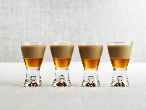Four drinks made with Amarula & maple syrup in shot glasses