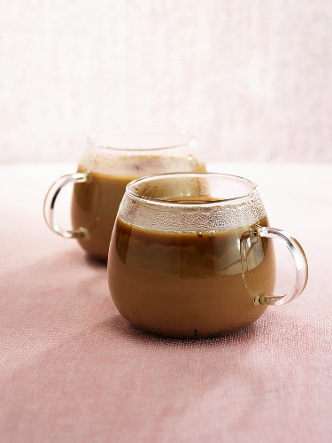 Coffee with Amarula (cream liqueur) in two glas cups