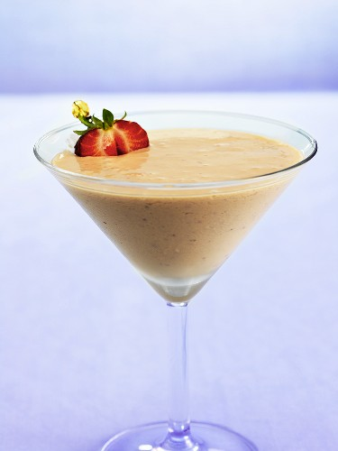 Amarula Cream cocktail with fresh strawberry in Martini glass
