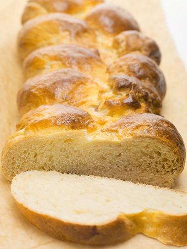 Bread plait, a slice cut