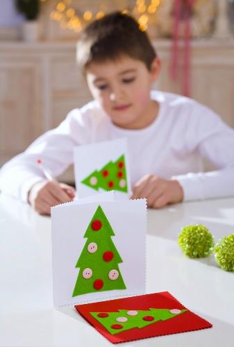 Boy writing Christmas cards