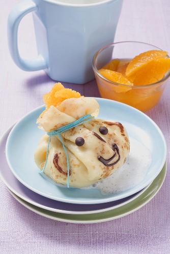 Pancake with oranges and vanilla milk foam