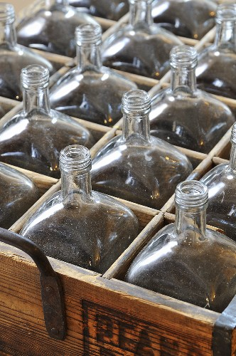Old glass bottles in a wooden crate