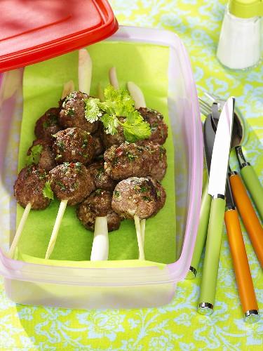 Meatballs on lemon grass skewers