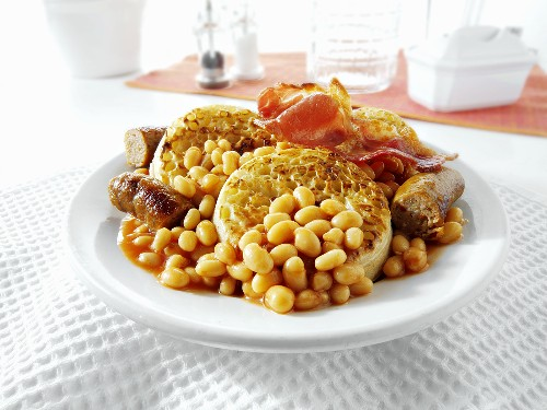 English breakfast: crumpets, sausages, bacon, baked beans
