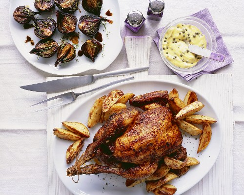 Paprika chicken with potato wedges and caper aioli