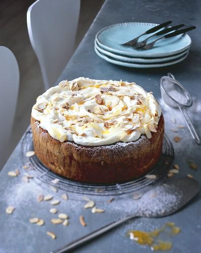 Apricot almond cake with yoghurt cream on cake rack
