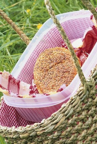 A bread roll in a picnic basket