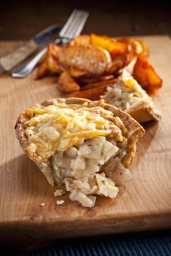 Homity Pied (vegetable pie, England), slice open, with potato wedges