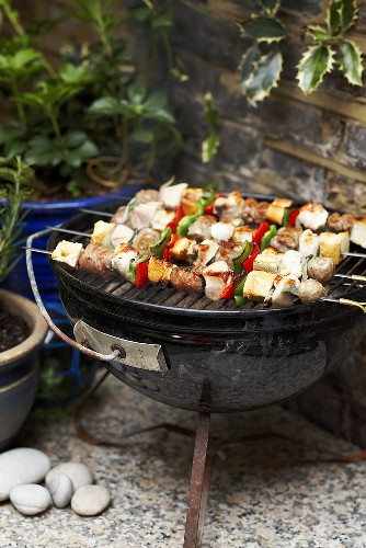 Chicken, vegetable and sausage kebabs on the barbeque