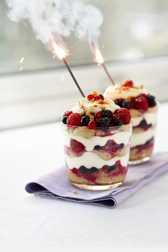Berry trifle with burning sparklers