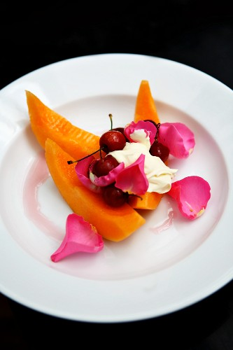 Honeydew melon with cherries, creme fraiche and rose petals