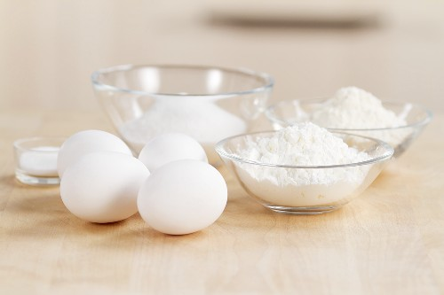 Ingredients for biscuit dough: flour, eggs and sugar