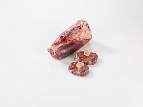 Raw knuckle of veal with two slices