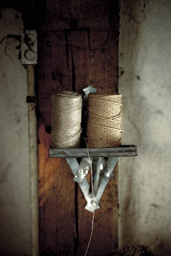 Rolls of yarn on a wall bracket