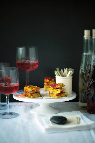 Cardinale (Campari aperitif) and a potato tortilla with chorizo on a buffet table at a party