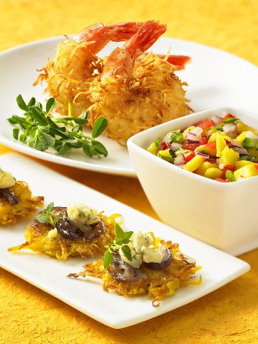 Various appetisers: potato cakes, coconut prawns and fruit salsa