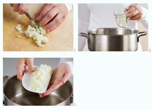 Onions being chopped and placed in a pot