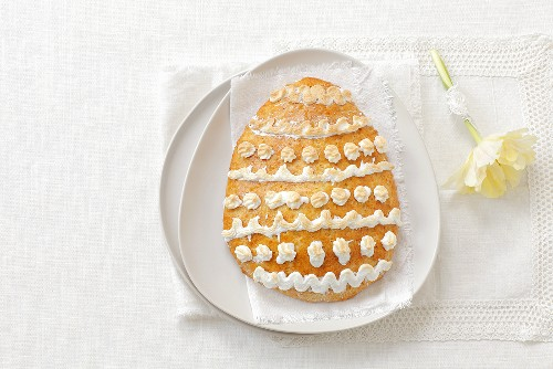 An egg-shaped almond biscuit with decorated with meringue